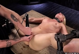 Blonde in innovative device bondage caned