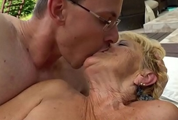 Busty granny doggystyled apart from youthful cock